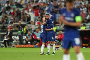 Eden Hazard gets a hug from Olivier Giroud as he makes his way off the pitch after being substituted.