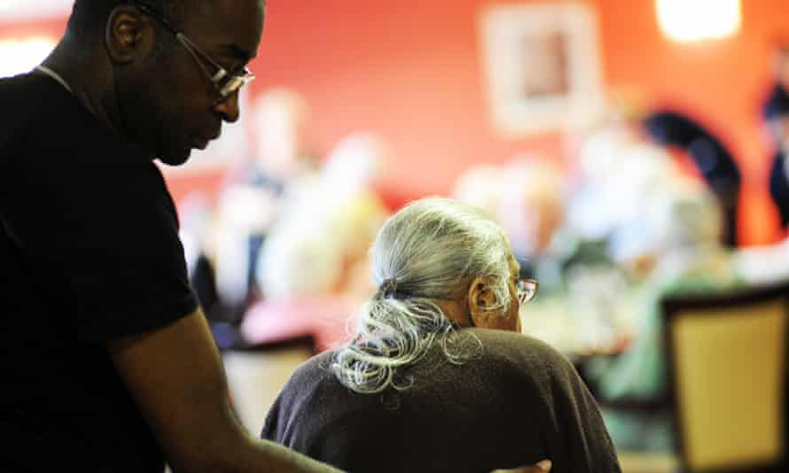 Care worker and resident at home