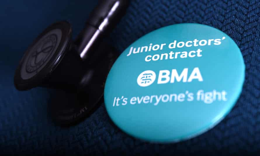 A doctor wearing an NHS badge in support of the junior doctors' strike