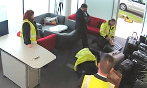A CCTV photo of Alessandro Iembo having his bag searched at Farnborough airport.