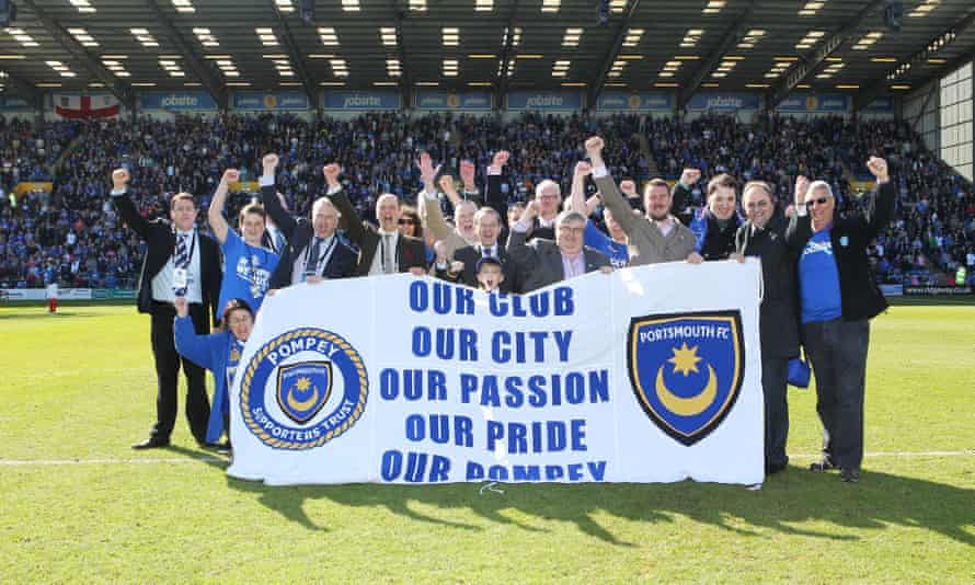 Portsmouth's supporters' trust celebrate after taking over the club in 2013. Its members will decide this month whether to sell to the US businessman Michael Eisner.