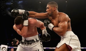 Anthony Joshua throws a right hand over the top of Joseph Parker on Saturday night.