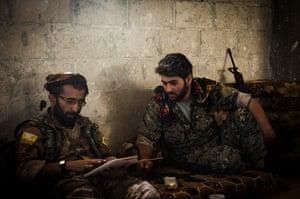 Dalil, left, from Batman in Turkey, and Hazam, from Kobani, in their base in Raqqa.