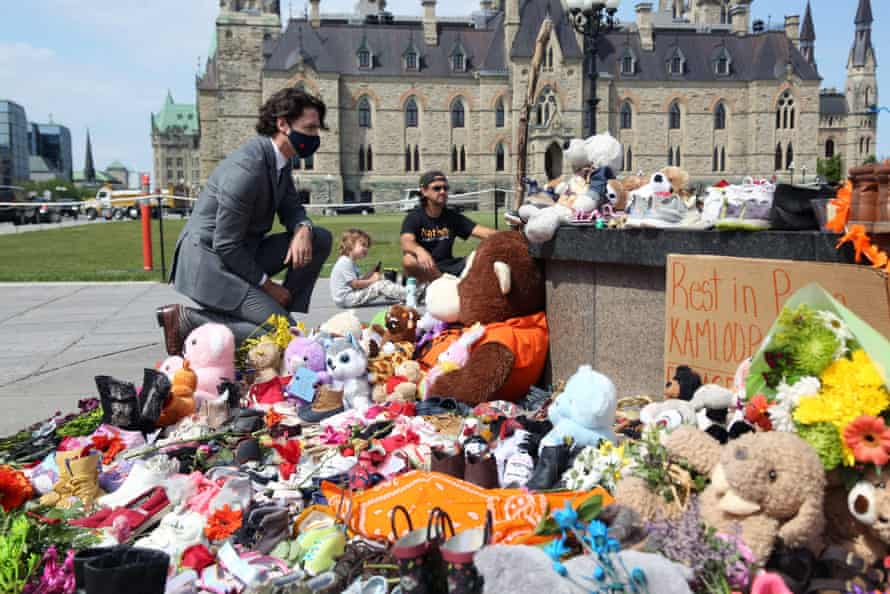 Justin Trudeau visits the makeshift memorial erected in honor of the 215 indigenous children remains found at a boarding school in British Columbia, on Parliament Hill in Ottawa.
