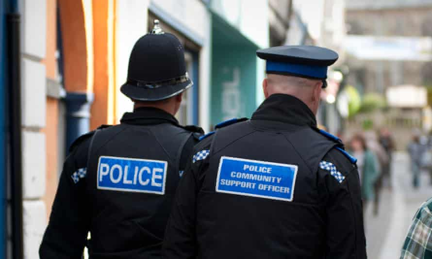 A police officer and a police community support officer on the beat.