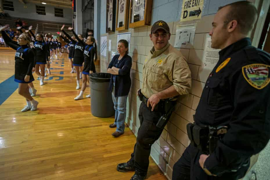 Deputy Sherrif David Stamper stops off at the Saturday local college basketball game.