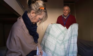 Angela Macintyre and volunteer Frank Gaunt making up beds in sleeping pods at the Cornerstone day centre in Manchester.