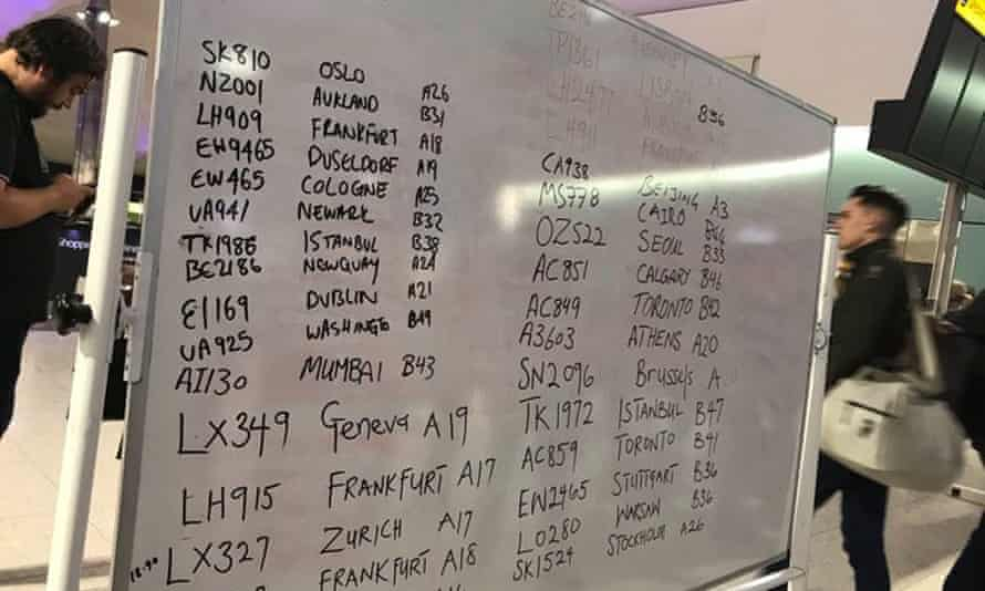 Flight information displayed on whiteboard at Heathrow airport
