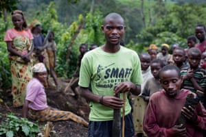 Mirindi Songolo, 23 years old, an autochthon, with other Pygmy people in an area of newly felled trees on the edge of the Kahuzi-Biéga national park near Bukavu
