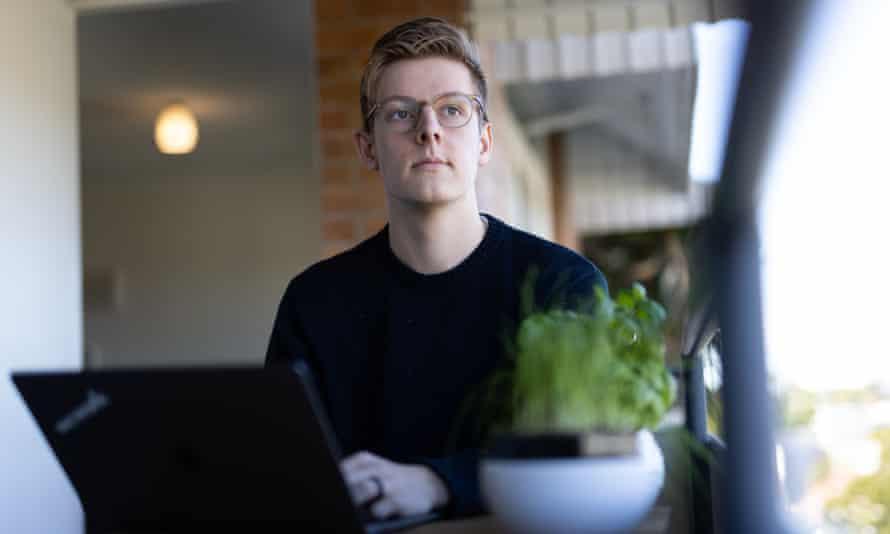 Jaimyn Mayer at his laptop