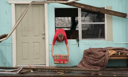 A man removes some possessions from his home in the aftermath of Hurricane Harvey.