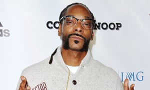 Snoop Dogg arrives at the premiere of Coach Snoop.