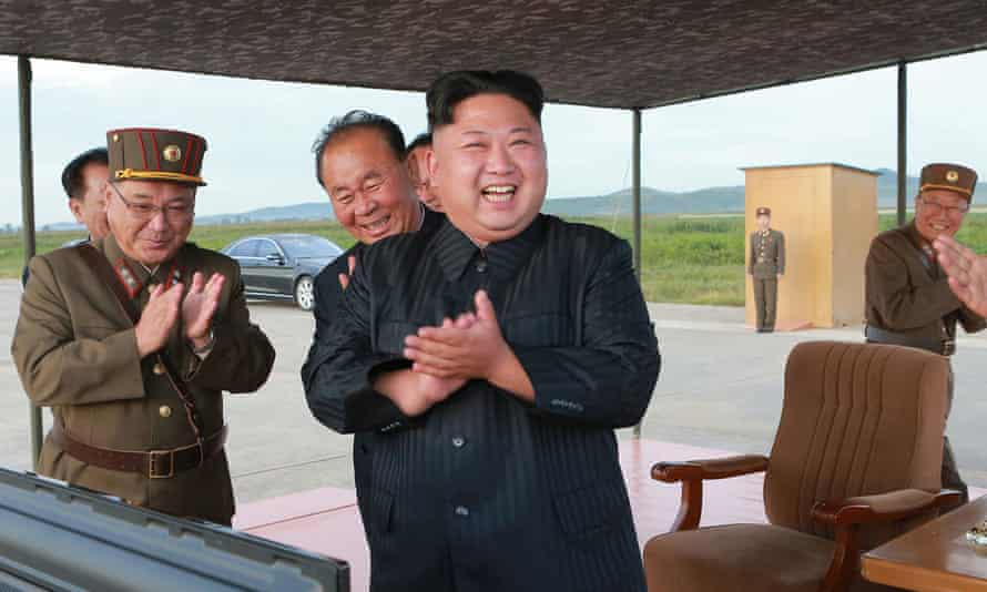 North Korean leader, Kim Jong-Un, celebrates what was said to be the test launch of an intermediate range missile.