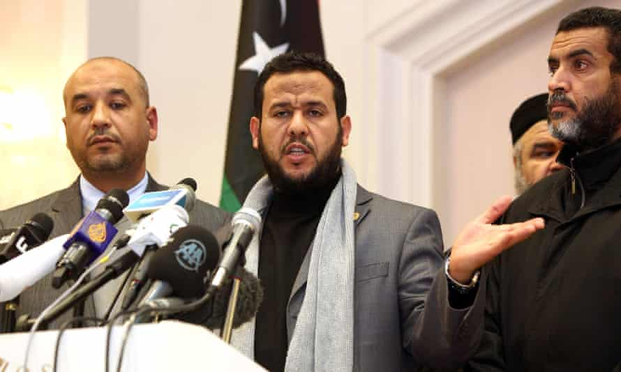 Abdul Hakim Belhaj, centre, speaks during a press conference in Tripoli in 2012.
