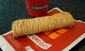 A Greggs vegan sausage roll and hot drink.