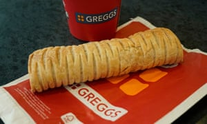 A Greggs vegan sausage roll lays on a table