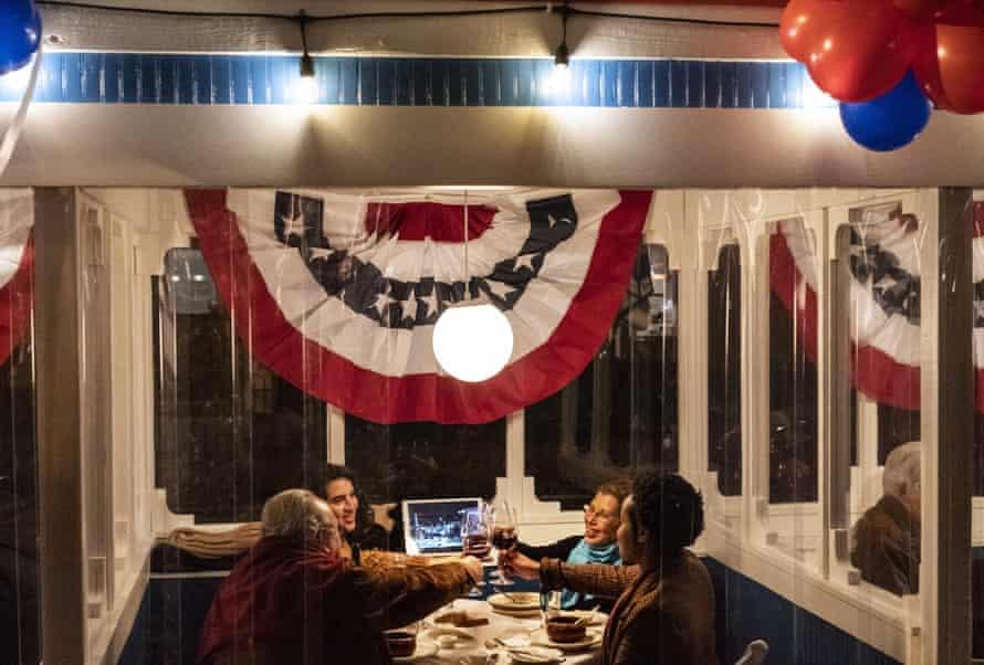 Diners celebrate Joe Biden's inauguration at Le Diplomate restaurant in Washington DC.