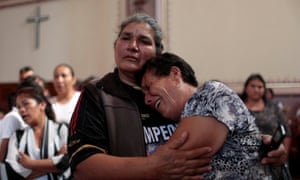 Parishioners react during a funeral mass for Jose Alfredo López Guillén at the St Trinity church in the town of Janamuato.