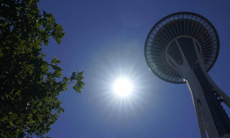 The sun shines near the Space Needle in Seattle on 28 June, as temperature records in the city were broken.