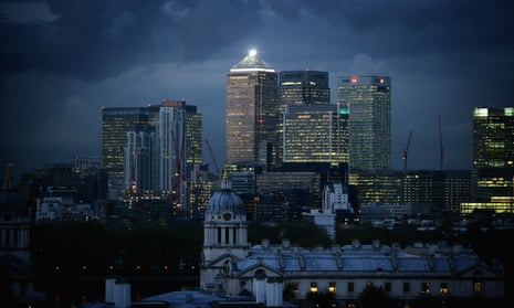 Storm clouds gather over the financial district of London's Canary Wharf in 2008.