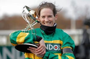 A beaming Rachael Blackmore holds the winner's trophy after her historic victory in the 2021 Grand National on Minella Times.