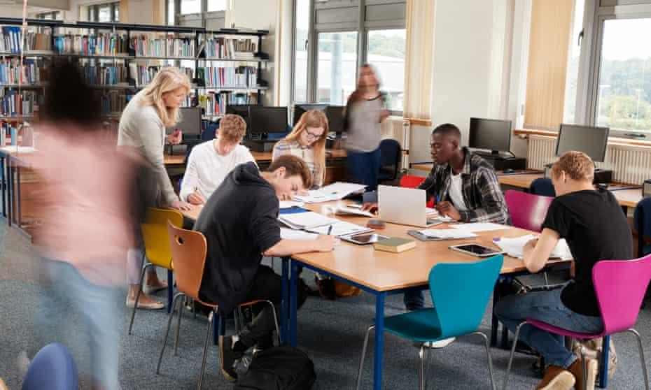 students around a desk