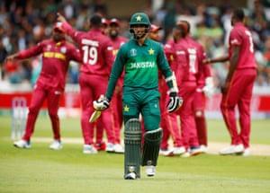 Pakistan's Hasan Ali looks dejected as he walks off after losing his wicket.