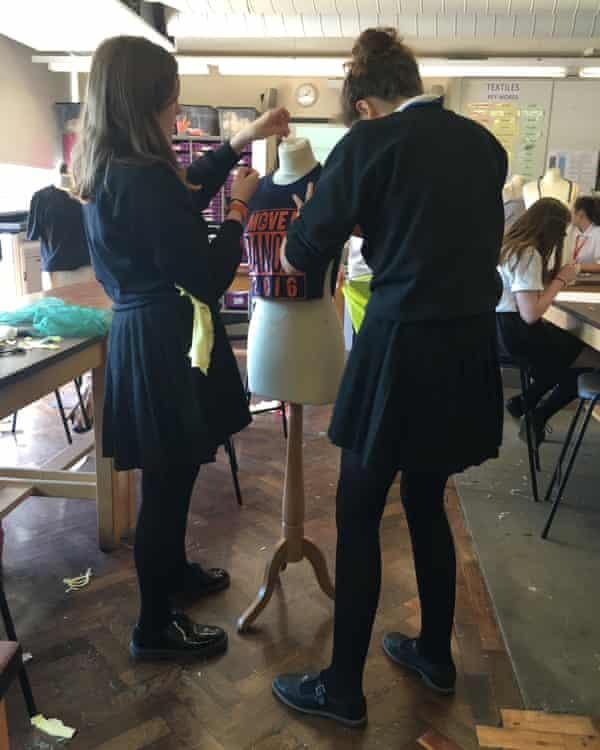 Students use an old t-shirt to create a new piece of clothing.