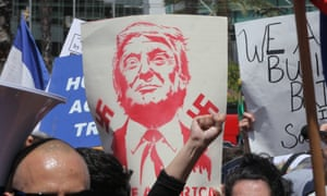 A sign held by protester depicts Donald Trump as a Nazi.