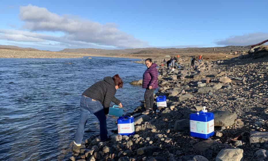 Residents collect water from the Sylvia Grinnell River near Iqaluit. The city's investigation into its main drinking water source began last week after residents complained their tap water had a gasoline-like smell.