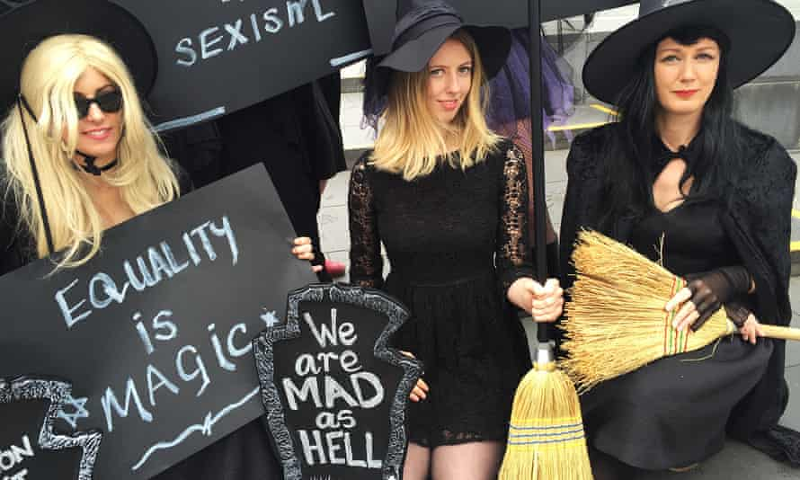 Women dressed as witches with placards reading 'Equality is magic', 'We are mad as hell'.