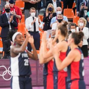 Emmanuel Macron and Jill Biden watch basketball at the 2021 Tokyo Olympics.
