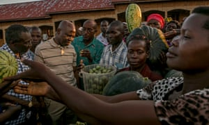 Ifad's president Gilbert Houngbo, second from left, speaks to farmers during a field visit to Mayuge District in eastern Uganda.