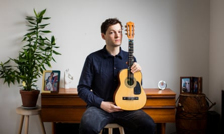 Douglas MacGregor, with the guitar bought for him by his mother