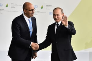 Russian president Vladimir Putin shakes hands with French junior minister for European affairs, Harlem Desir, upon his arrival for the opening session of COP21 at Le Bourget, in Paris, on Monday