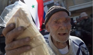 Russian humanitarian aid is handed to a man in Hama, Syria.