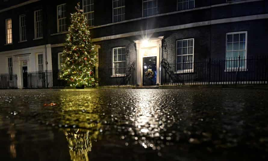 10 Downing Street at night with a large Christmas tree