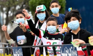 Kuwait health ministry reports three new cases of coronavirus, raising total to nine.Children use protective masks as they play with a water gun as they celebrates the country's national day and liberation day in Kuwait city, Kuwait, 25 February 2020.