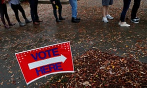 Voters wait in line to cast their votes in the midterm election in Atlanta on Tuesday.