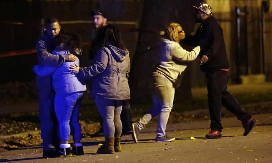 Family members react to the shooting of Jovan Wilson on the night of 18 November.