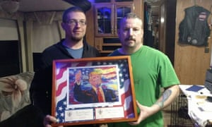 John Beavers, right, was presented with a framed replica of a Trump portrait following the violent clashes in Berkeley, California.
