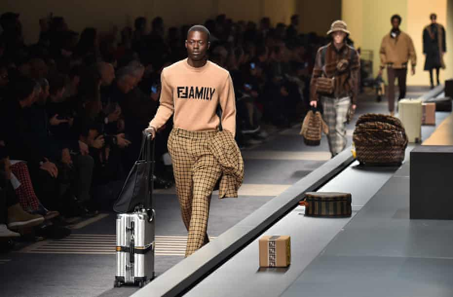 A model walks the runway at the Fendi show in Milan.