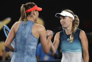 Russia's Maria Sharapova, left, is congratulated by Denmark's Caroline Wozniacki after winning their third round match at the Australian Open tennis championships in Melbourne.