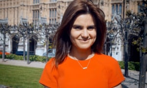 Jo Cox MP stands in front of the Houses of Parliament