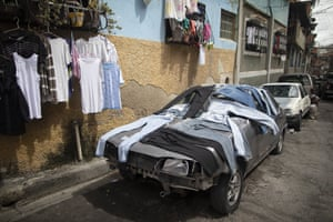 Caracas, Venezuela: laundry is dried on a decommissioned car in the Petare neighbourhood