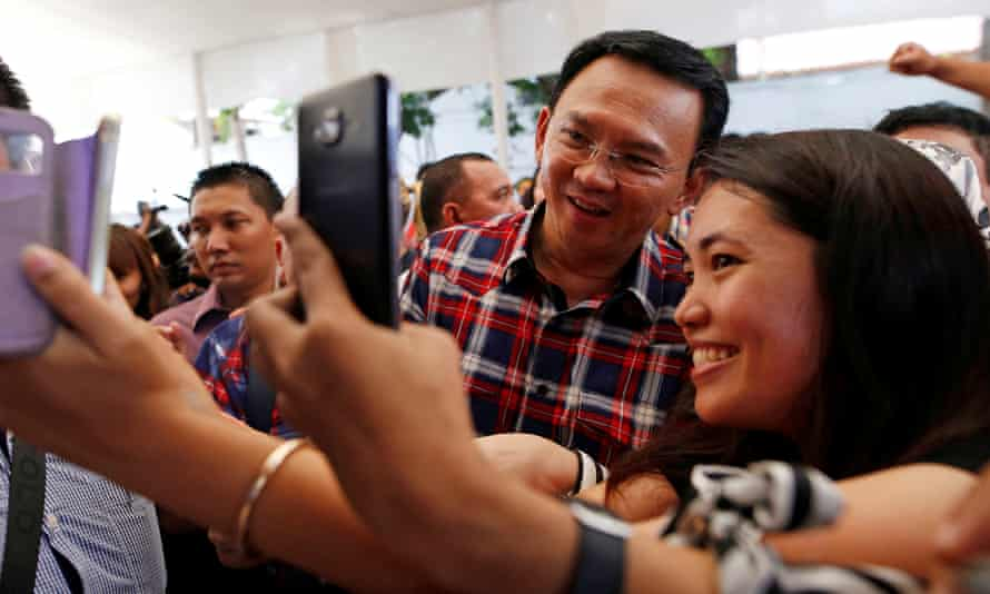 Jakarta governor Ahok campaigning for re-election. He has been named as a suspect in a blasphemy investigation.