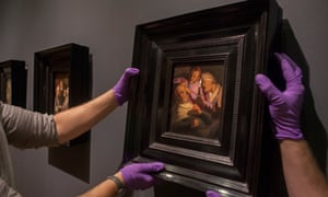 Staff hang one of the Rembrandt works at the Ashmolean