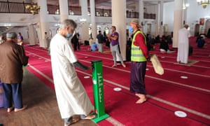 """Algerian Muslims gather at al-Falah Mosque to pray. The country has entered what the government describes as a """"concerning phase"""" of Covid-19 spread."""