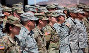 Members of the Arizona national guard listen to instructions in Phoenix. The additional troops would bolster national guard forces already at the border.