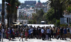 People gather in the street of Nice to pay tribute to the victims of the attack. Dozens of people have appealed through social media to find missing loved ones.